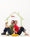Young couple in their new home painting Royalty Free Stock Photography