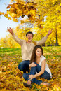 Young couple throwing autumn leaves Stock Photo