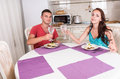 Young Couple Toasting Before Eating Meal Together Royalty Free Stock Photo
