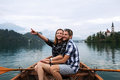 Young couple of tourists on wooden boat on the Lake Bled, Slovenia Royalty Free Stock Photo
