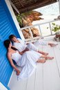 Young couple in tropical beach house Stock Image