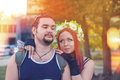 Young couple ukrainians girl with red hair and a national wreath embraces favorite guy Stock Photos