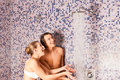 Young couple under experience shower Royalty Free Stock Images