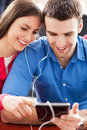 Young couple using digital tablet Stock Image