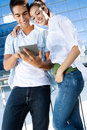 Young couple using a digital tablet outdoor portrait of one Royalty Free Stock Photos