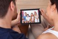Young couple using digital tablet together high angle view of at home Stock Photos