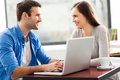 Young couple using laptop smiling Stock Photography