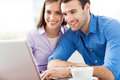 Young couple using laptop smiling Stock Image