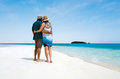 Young couple visit aitutaki lagoon cook islands male and female hugs on the white sand of Stock Photos