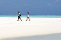 Young couple visit aitutaki lagoon cook islands male and female walks on the white sand of Stock Photo
