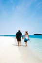Young couple visit aitutaki lagoon cook islands male and female walks on the white sand of Stock Image