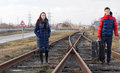 Young couple waiting for the train on the tracks Royalty Free Stock Photo