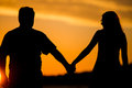 Young couple walk on the sunset happy Royalty Free Stock Photography