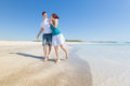Young couple walking on caribbean beach in a Royalty Free Stock Images