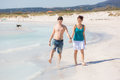 Young couple walking on caribbean beach enjoying life in a Royalty Free Stock Images