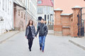 Young couple walking in an old town outdoors Royalty Free Stock Images