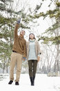 Young couple walking in a park in winter with snow Royalty Free Stock Photo
