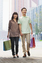 Young couple walking with shopping bags in hands beijing china Royalty Free Stock Photos