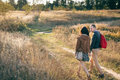 Young couple walking at sunset Royalty Free Stock Photo