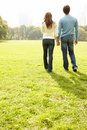 Young couple walking together in a field Royalty Free Stock Images