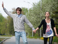 Young couple walking together in park Stock Photography