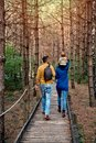 A young couple walks in the woods with a little boy Royalty Free Stock Photo