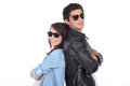 Young couple wearing sunglasses and trendy clothing Royalty Free Stock Photo