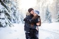 Young couple in the winter park have a walk Stock Photos