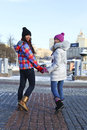 Young couple women in winter street happy Stock Image