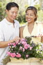 Young Couple Working In Garden Stock Image