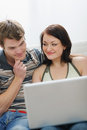Young couple working on laptop Royalty Free Stock Images