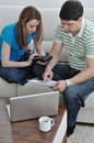 Young couple working on laptop at home Royalty Free Stock Photos