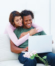 Young couple working on laptop in house Royalty Free Stock Image