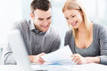 Young couple working together smiling Stock Photo