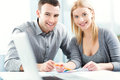 Young couple working together smiling Royalty Free Stock Photo