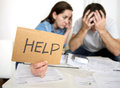 Young couple worried at home in bad financial situation stress asking for help