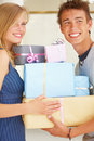 Young couples holding gifts Stock Image