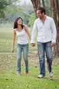 Young couples walk hand in hand Stock Photo
