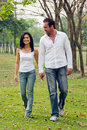 Young couples walk hand in hand Royalty Free Stock Image