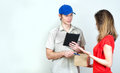 Young courier deliver package to pretty woman Stock Photography