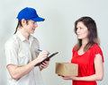 Young courier deliver package to pretty woman Royalty Free Stock Image