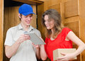 Young courier deliver package to pretty woman Stock Photo