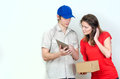 Young courier deliver package to pretty woman Royalty Free Stock Photography