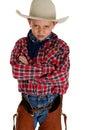 Young cowboy glaring at camera wearing hat and cha Royalty Free Stock Photo