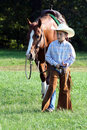 Young cowboy walking horse Royalty Free Stock Photography