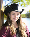 Young cowgirl in hat Royalty Free Stock Image