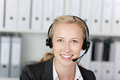 Young customer service executive using headset closeup of female in office Stock Image