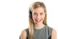 Young customer service representative wearing headset close up portrait female smiling against white background Royalty Free Stock Photos