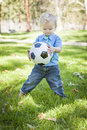 Young Cute Boy Playing with Soccer Ball in Park Royalty Free Stock Photo