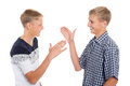 Young cute brothers greet each other hands Royalty Free Stock Images